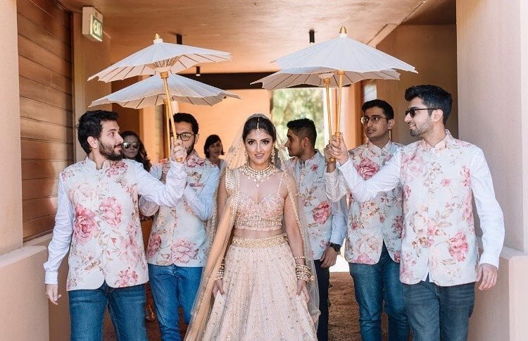 bridal entry with brothers holding paper umbrella
