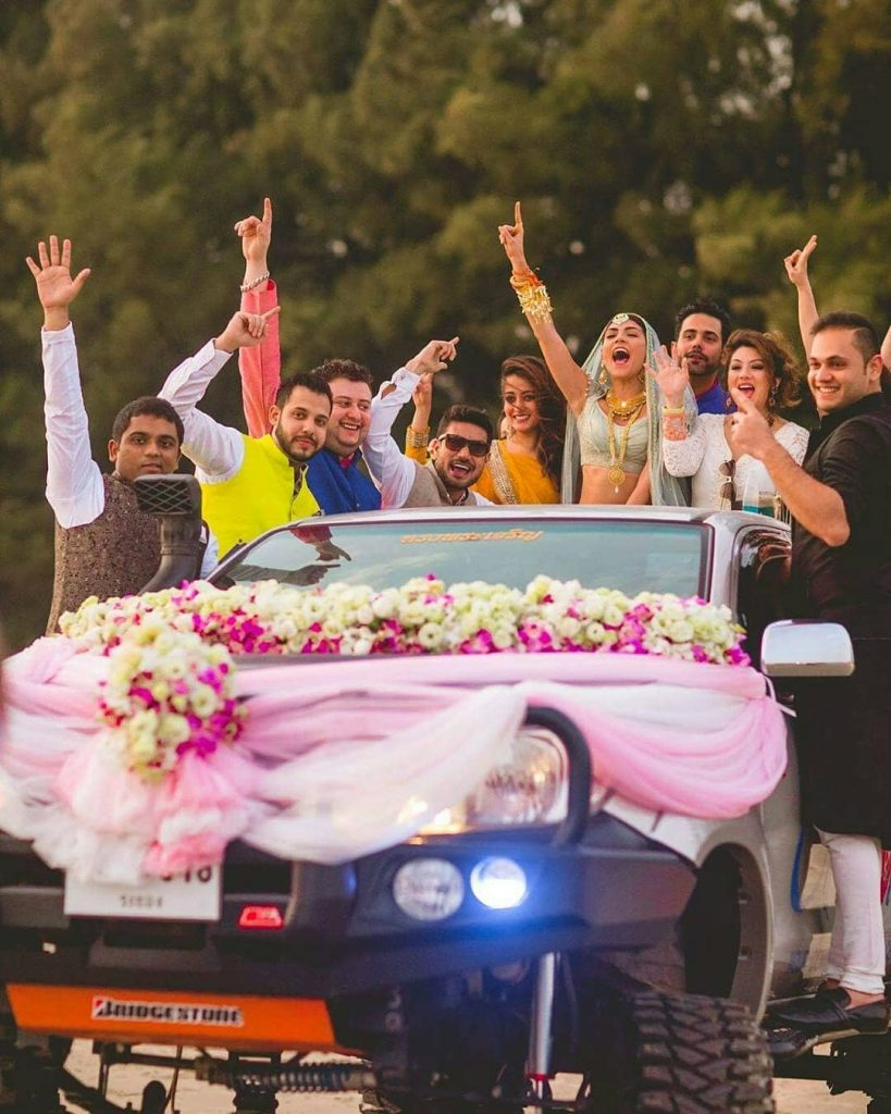 Bride entering with her friends in a car