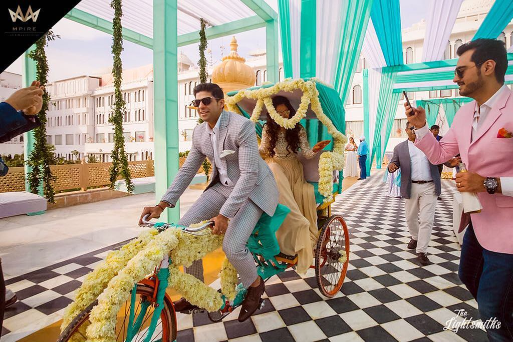 Fun Rickshaw bride and groom entry for sangeet