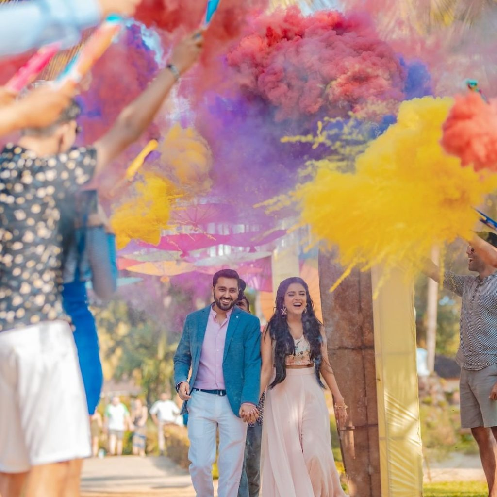 Quirky Smoke bomb bride and groom entry ideas for sangeet