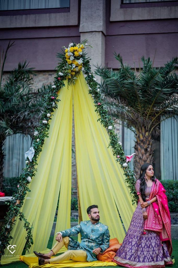 yellow canopy decorated with vines and flowers