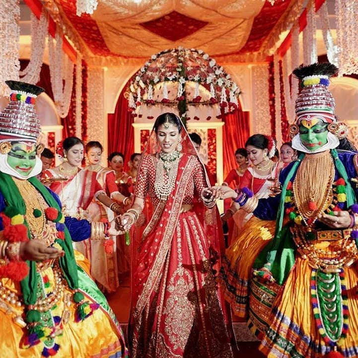 bridal entry with umbrella and dancers