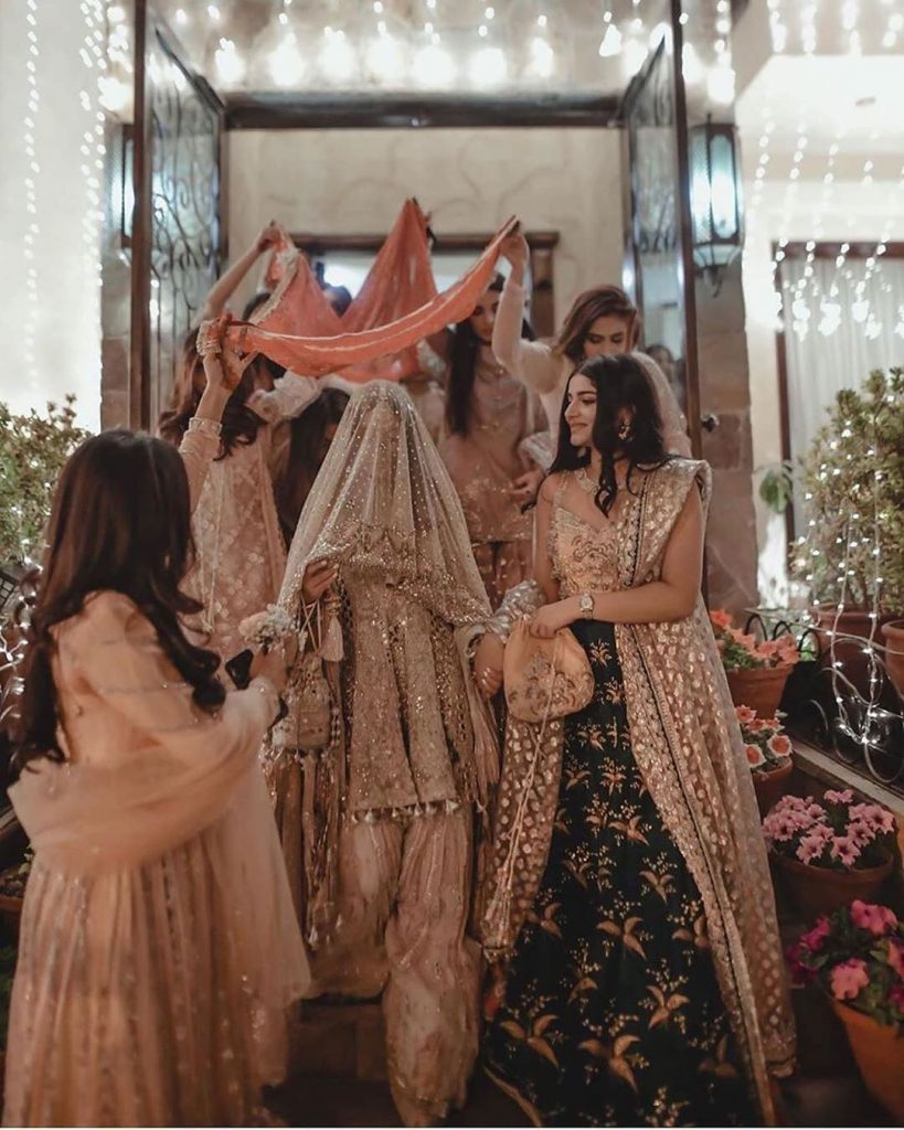 wedding entry with bridesmaids holding your bridal chaadar