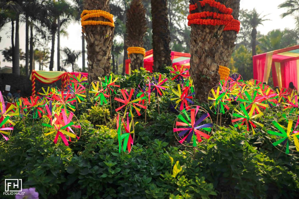 Garden decorated with marigold flowers and pinwheels