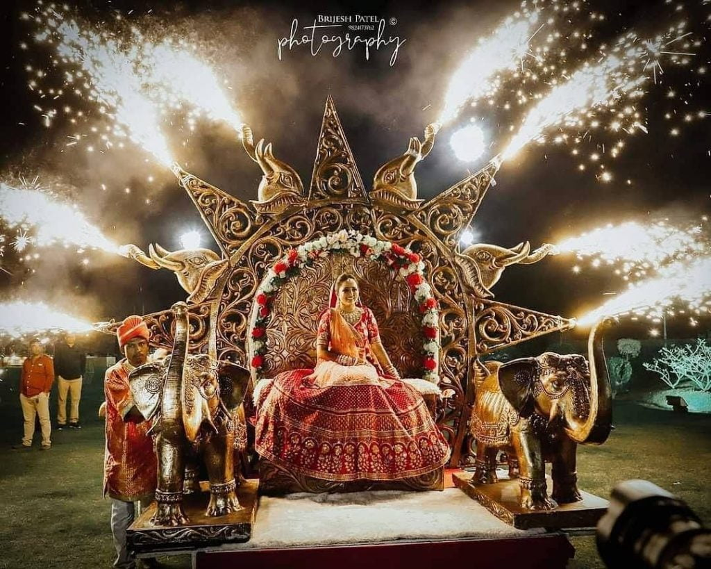 Grand bridal entry idea with royal carriage and fireworks