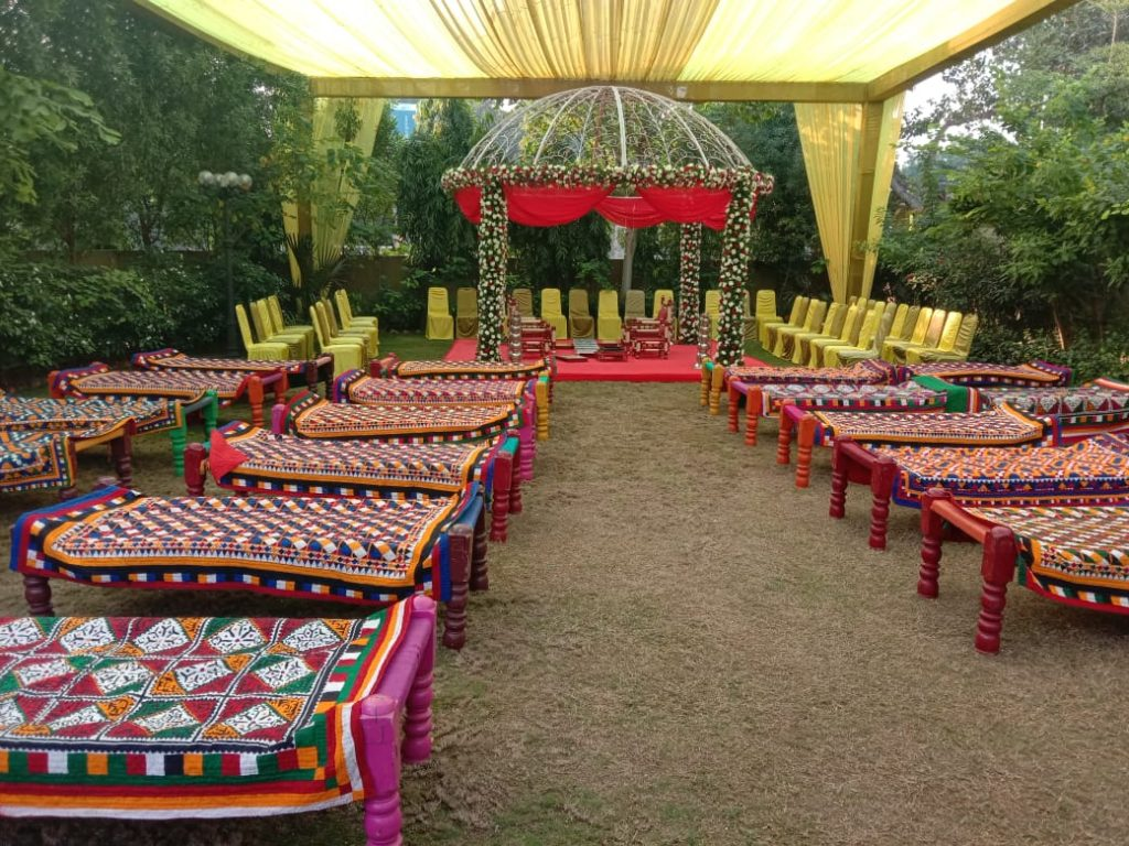 khats decorated in traditional prints as seating arrangement