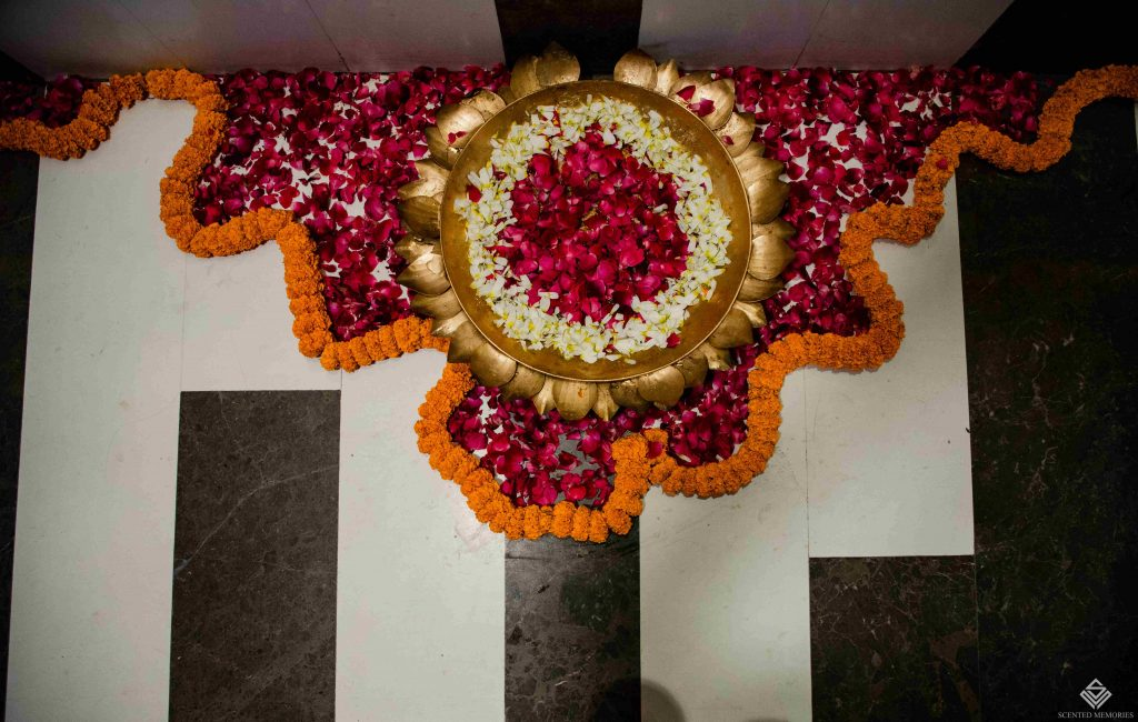 indoor mehndi decoration with roses and marigolds