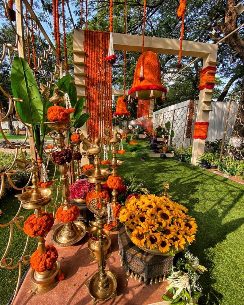 entrance décor with marigolds flowers and gold accessories