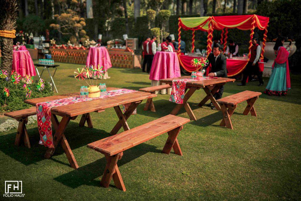 mehendi decoration ideas with vibrant colour scheme and pinwheels as table décor