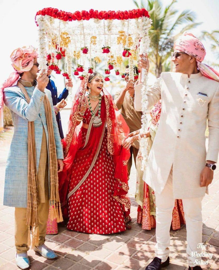 Bridal entry under a flower and kaleera chaadar