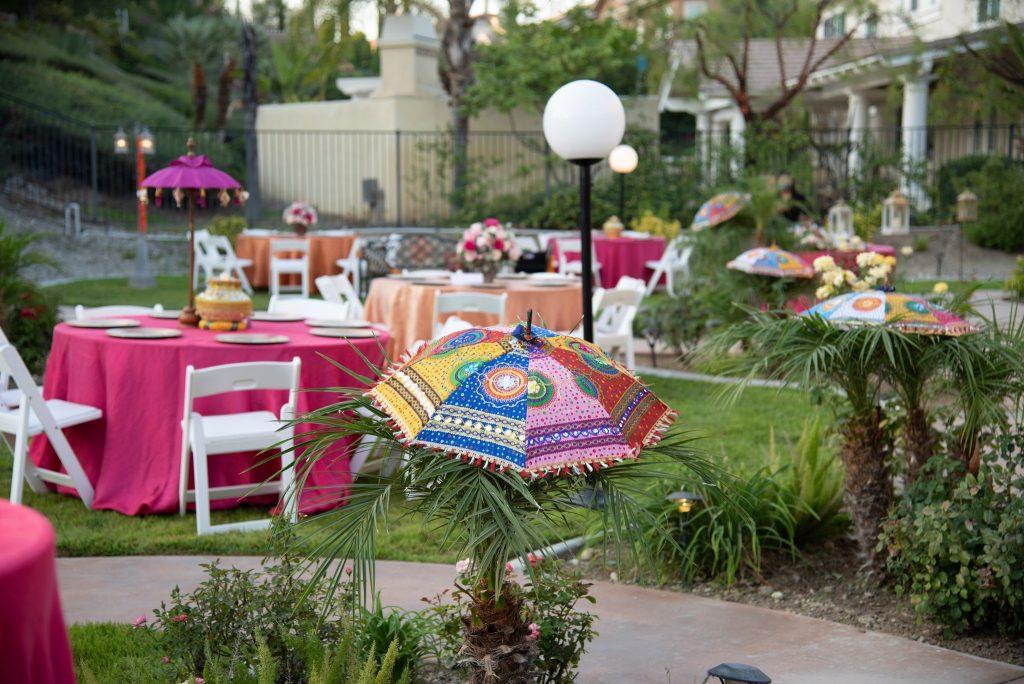 Pink garden decoration with quirky umbrellas