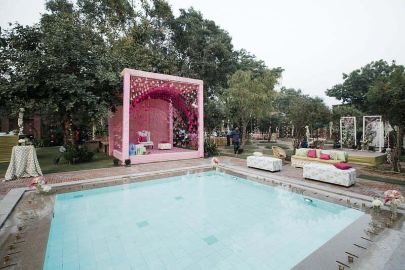 poolside mehendi decorations in pink color scheme