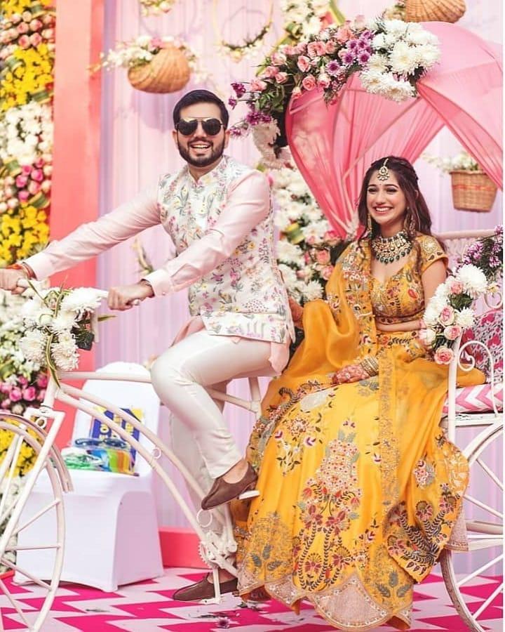 bridal entry idea with groom on a rickshaw