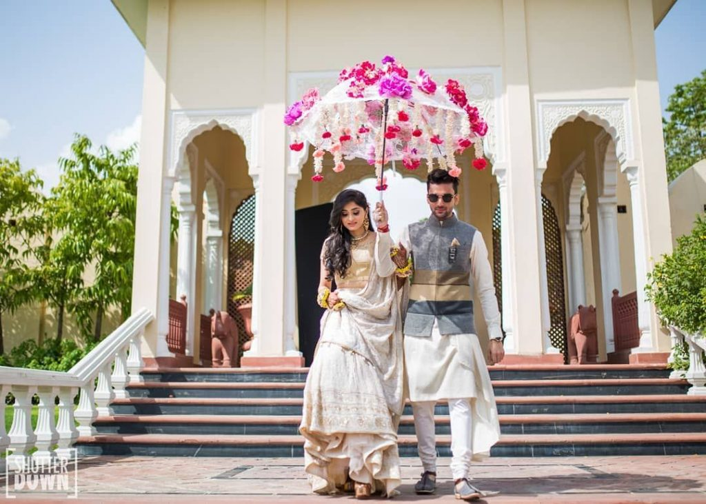 floral umbrella simple bride and groom ideas for sangeet