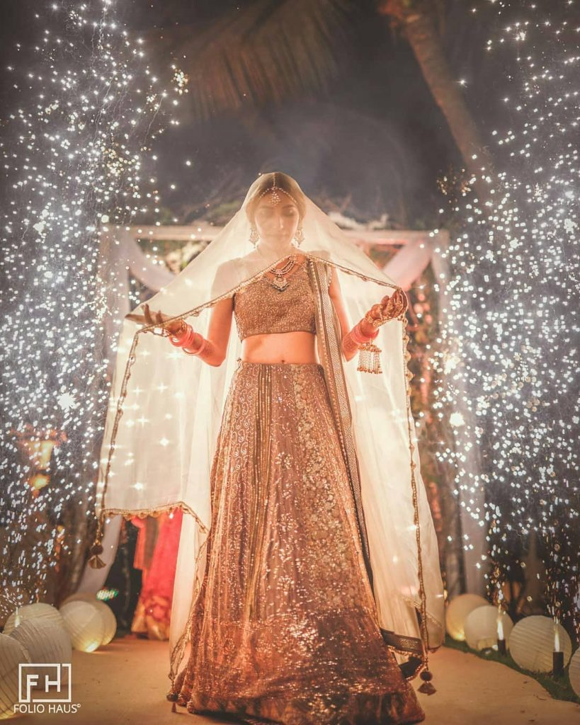 Bride entering with dupatta veil and fireworks