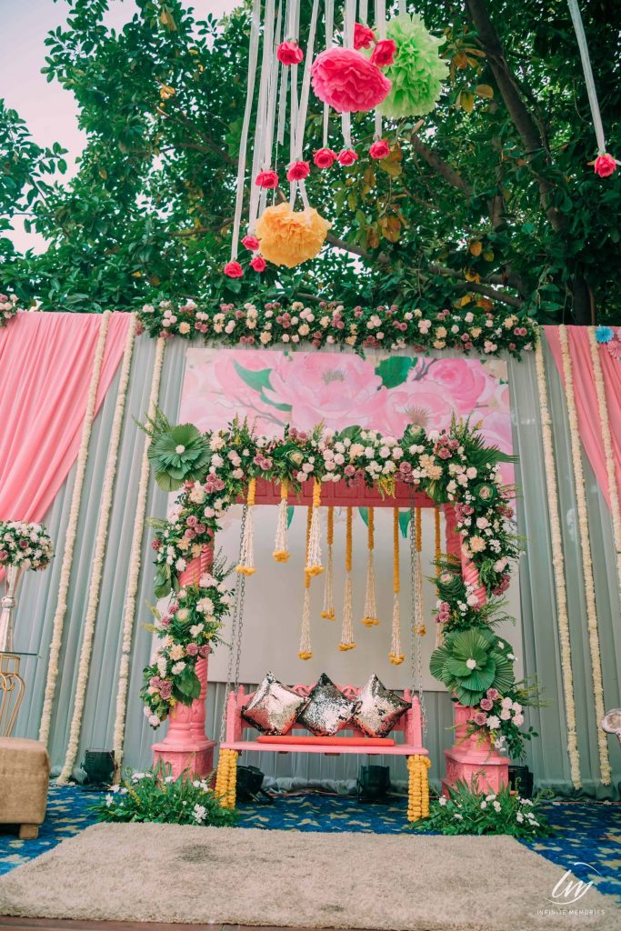 swing decorated with pink flowers and vines