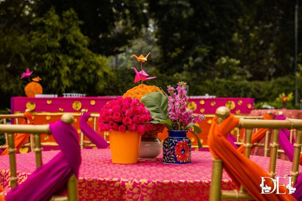 table decoration with flowers and old kettles