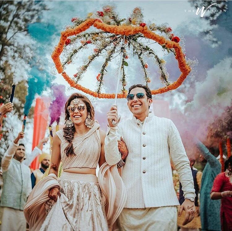 floral umbrella bride and groom entry concept