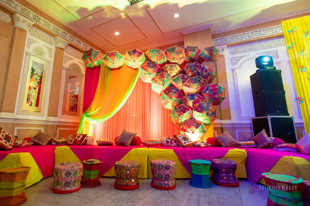 quirky umbrella mehendi decoration in yellow and pink tone