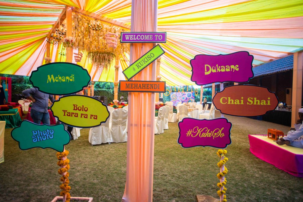 multicolor signboards with directions as mehendi decoration ideas