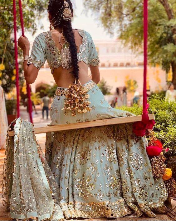 bride in braid and heavy golden parandi