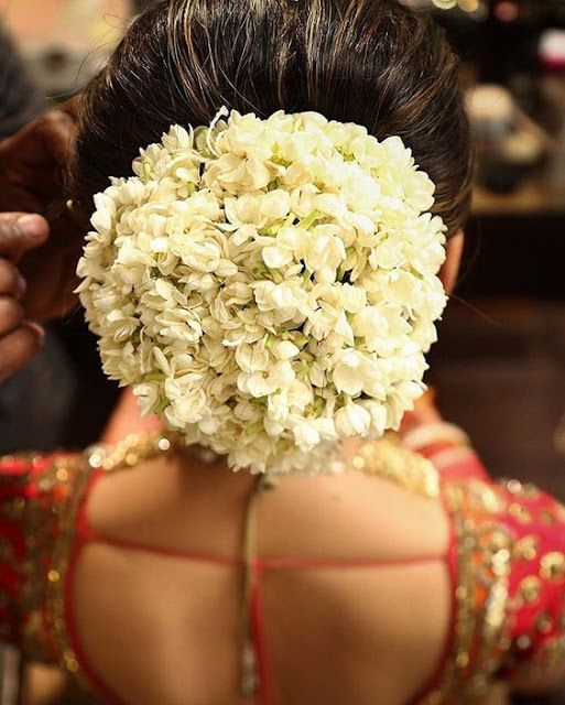 bridal hairstyle for round face with jasmine flowers