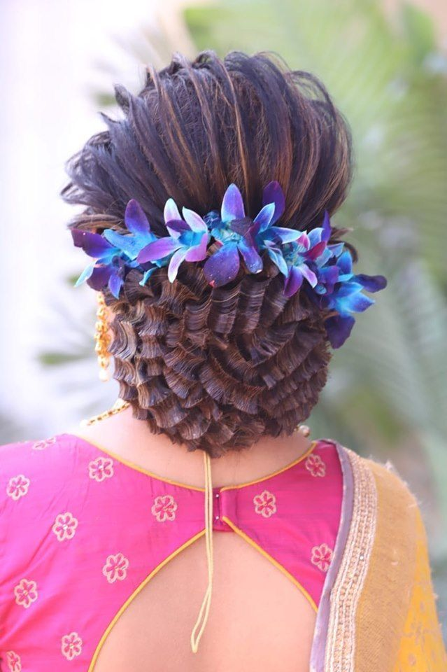 bridal bun decorated with orchid flowers