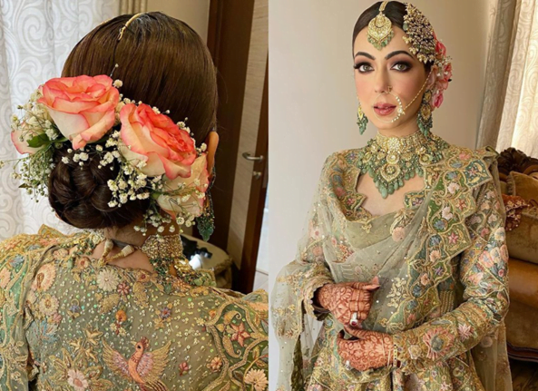 punjabi bride in a low bun adorned with flowers