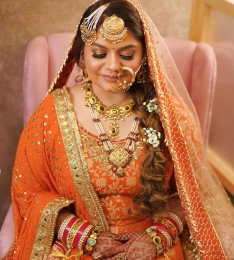 bride in a plaited braid decorated with flowers