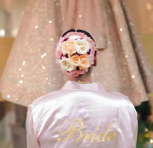 bridal bun with pastel flowers
