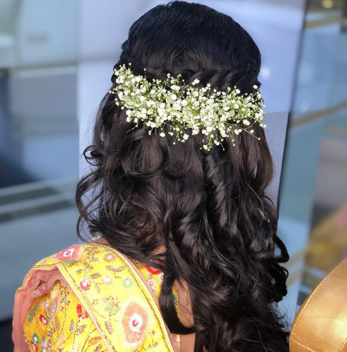 jasmine floral bridal hairstyle for round face