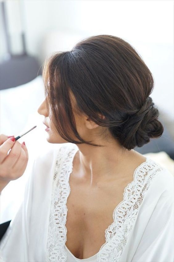 getting ready shot of the bride with her hair in a chignon bun