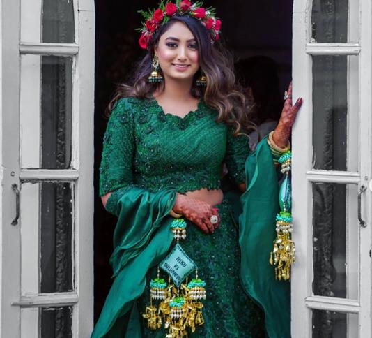 bride in a rose tiara and matching kaleere