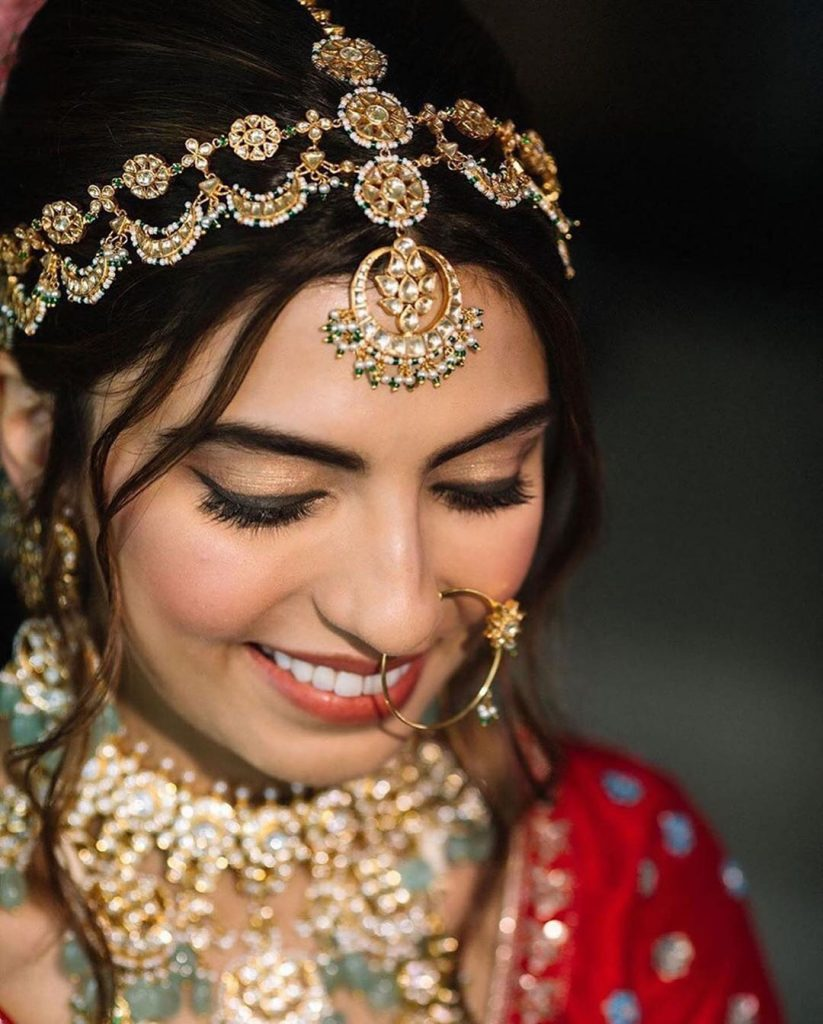 bride in maang tikka and headband