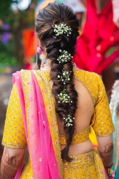 bride in french braid with fresh baby's breath