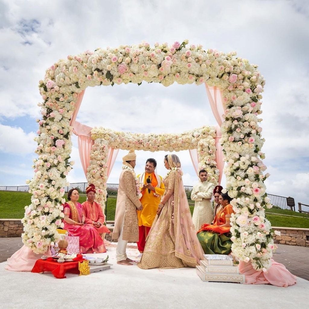 Couple floral mandap hindu marriage date 2021