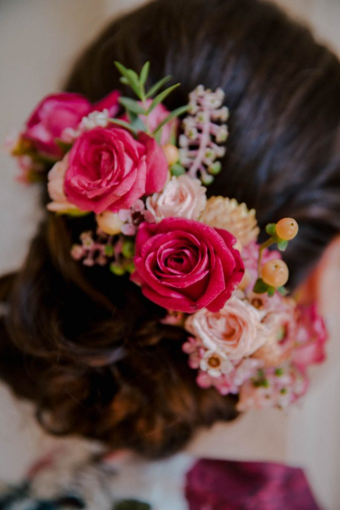bride in a bridal bun with flowers