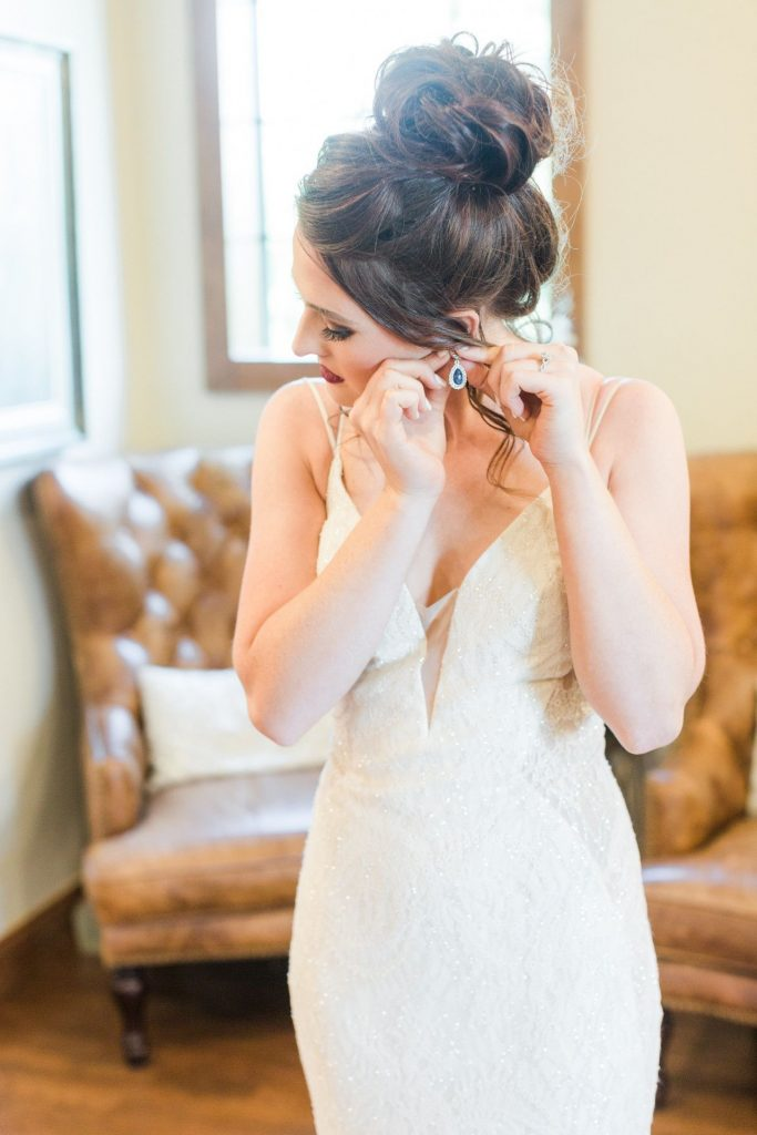 bride in high bun hairstyle for her wedding