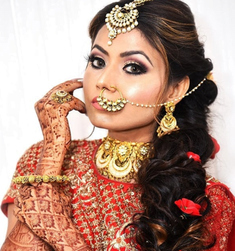 Bride in a traditional tied up hairstyle adorned with flowers