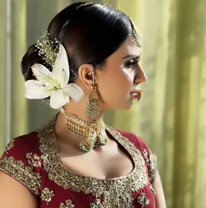 bride in a bridal bun with orchid flower