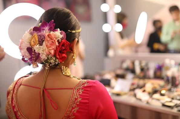 bridal bun with vibrant flowers