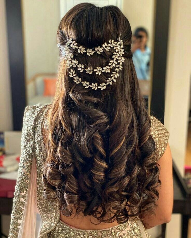 Open bridal hairstyle for round face with hair accessory