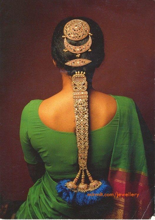 bride in a retro braid with heavy golden hair accessory
