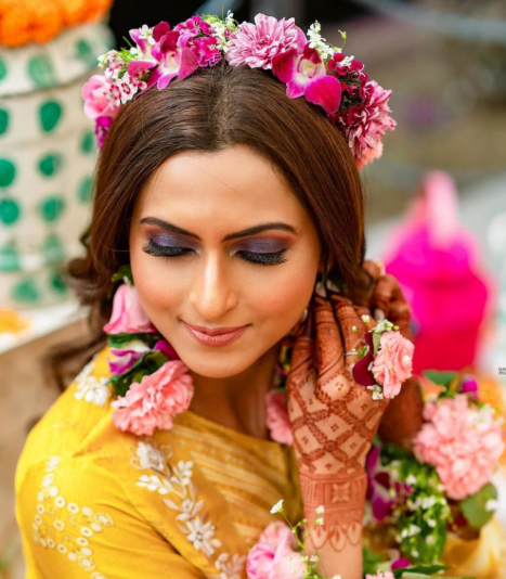 bride in a unique floral hairstyle