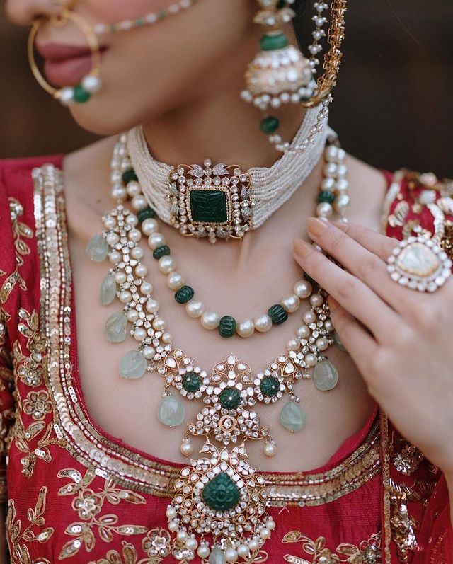 Layered indian bridal Jewellery with varying necklace types