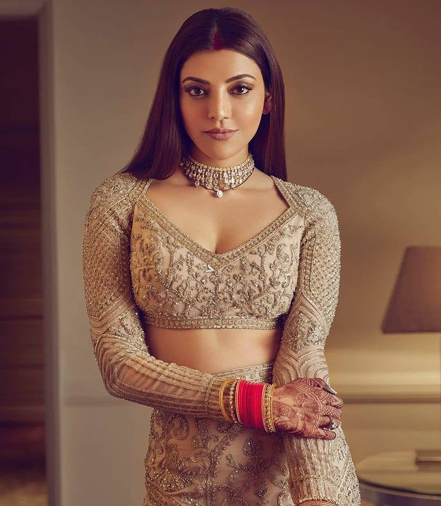 Kajal Aggarwal flaunting her diamond choker necklace with V neckline