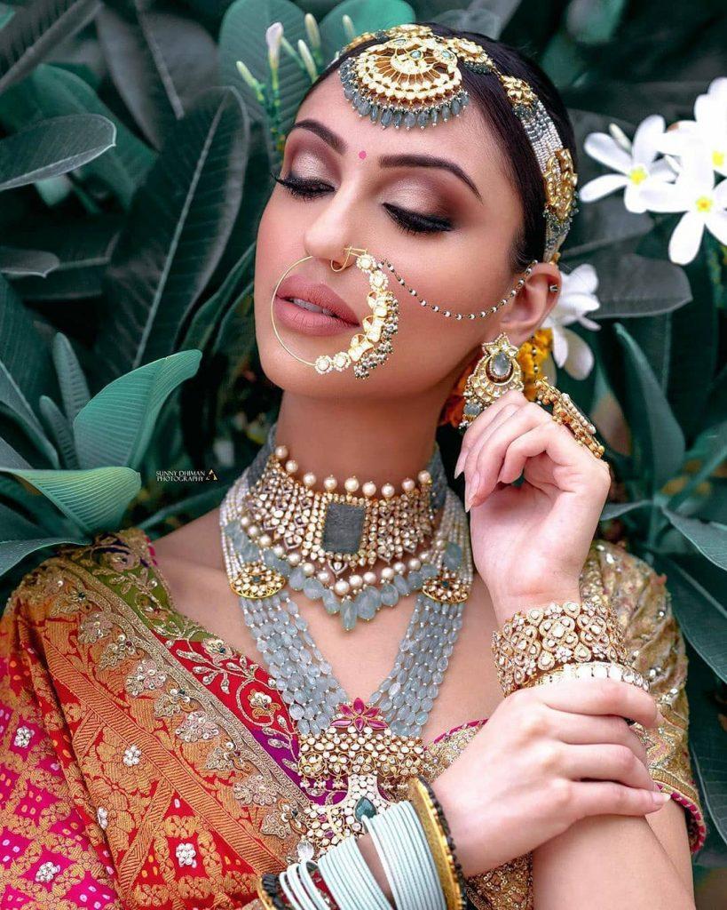 Contrasting grey hued indian bridal jewelry set with red and orange bridal lehenga