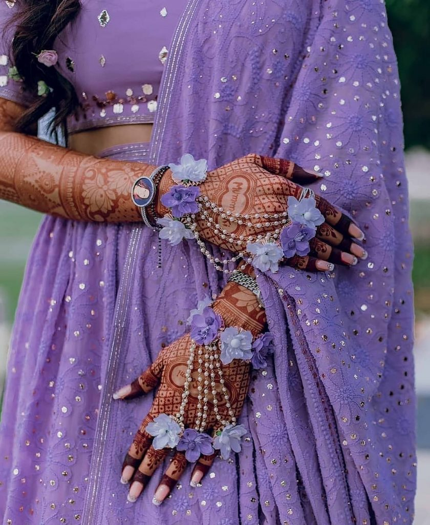 Lavender hued floral hathphool for haldi ceremony